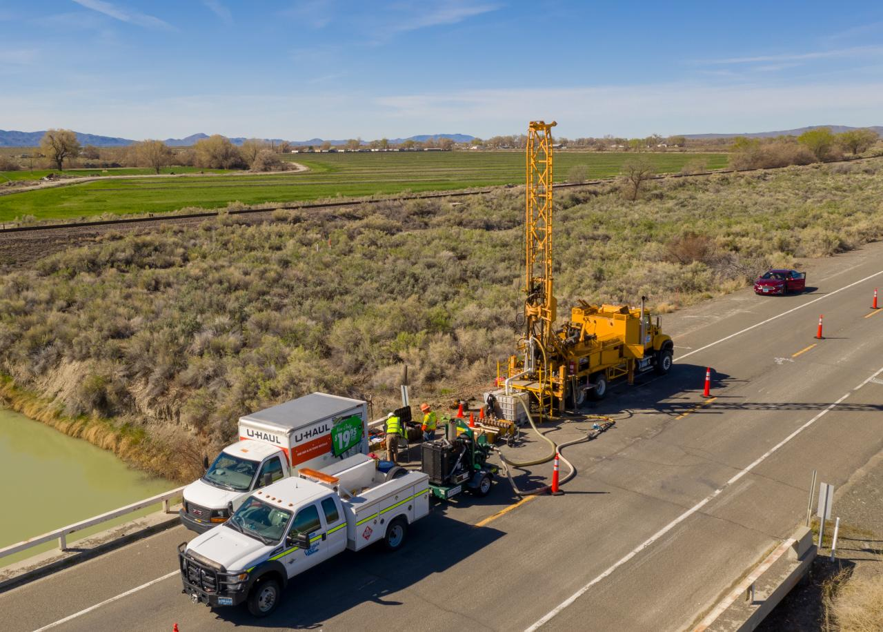 An aerial view of the drill rig and ISTD equipment sitting on a bridge and roadway in northern Nevada.