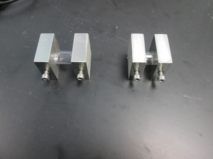 This photograph shows two different rectangular metal cell sizes.
