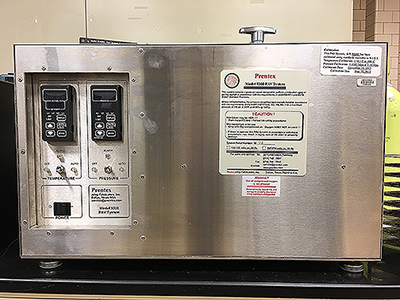 A picture of a Pressure Aging Vessel (PAV) that is used at the Binder Laboratory.