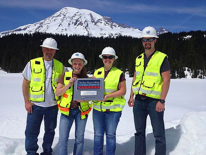 Western Federal Lands Highway Division staff pose with the Best Places to Work plaque at Mt. Rainier National Park, Washington