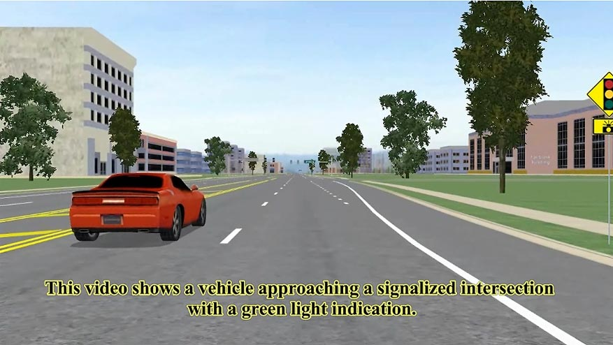 This video shows a vehicle approaching a signalized  intersection with a green light indication. When the vehicle nears the  intersection, a red light indicator located inside the cab begins to flash  alerting the driver of cross traffic that will be entering the intersection.  The purpose is to alert the driver to take evasive action.