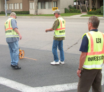Figure 2. Crash investigators take measurements at the scene of a motorcycle crash.