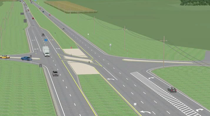 The image is a screenshot from the video. It shows a four-lane roadway (two lanes in each direction) separated by a grassy median. Within the median is a restricted crossover U-turn intersection. Vehicles are shown on the roadway.
