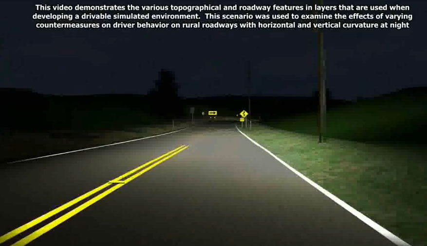 The image is a screenshot from the video. It shows a two-lane roadway at night, lit by a vehicle's headlights. Two road signs can be seen in the distance.