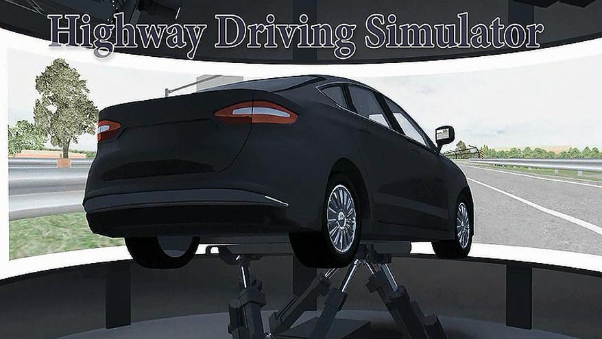 This  image shows the Highway Driving Simulator. A midsize vehicle is affixed on top  of a motion base system and faces a wraparound projection screen that displays a  roadway environment scenario.