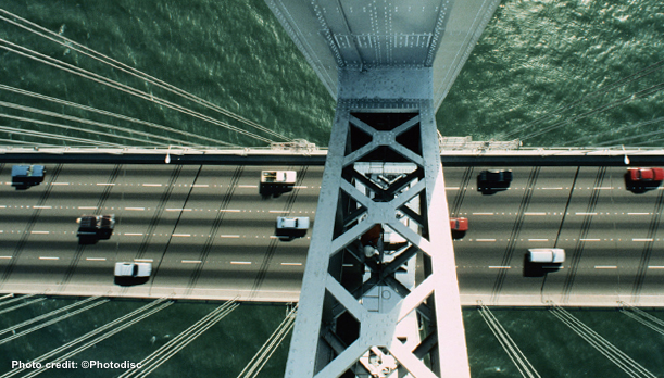 Overhead view of cars traveling on a bridge