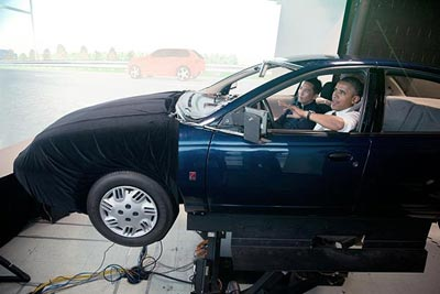 President Obama tours the Human Factors Highway Driving Simulator with Human Factors Team Leader David Yang.