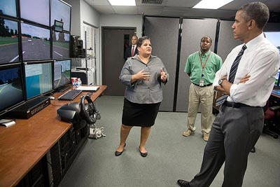 Monique Evans, Director of FHWA Office of Safety Research & Development, explains to President Obama the role that Safety R&D and the Highway Driving Simulator serves in reducing fatalities and serious injuries on the Nation's roadways.
