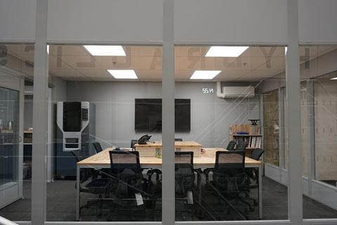 This photograph shows the lab conference room with Fortus 3D printer in far-left corner.