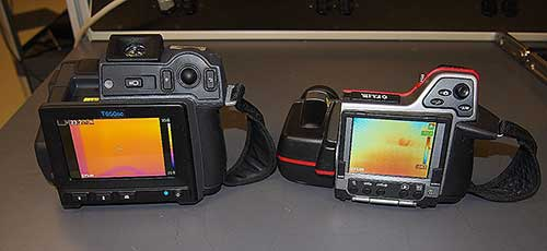This photograph consists of a specialized digital camera. The digital display is facing the viewer and has five control buttons. On the left rear side of the camera is a cylindrical piece. On the right is a hand strap. The cameras controls are in the upper right portion of the camera.