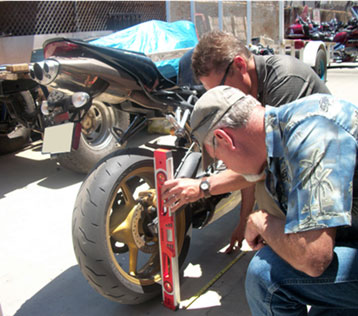 Figure 1. Crash investigators examine a crashed motorcycle.