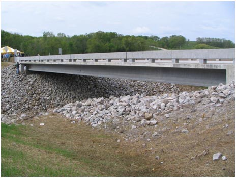 This Wapello County, Iowa, structure was the first UHPC bridge constructed in the United States.  The bridge includes three UHPC prestressed I-girders spanning a creek in rural Iowa.